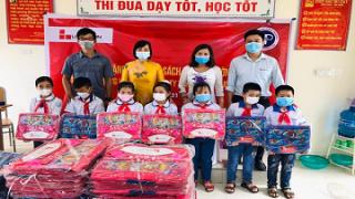 """Công ty xi măng Long Sơn khởi động chương trình """"Cặp sách em đến trường"""" trong mùa dịch COVID-19."""